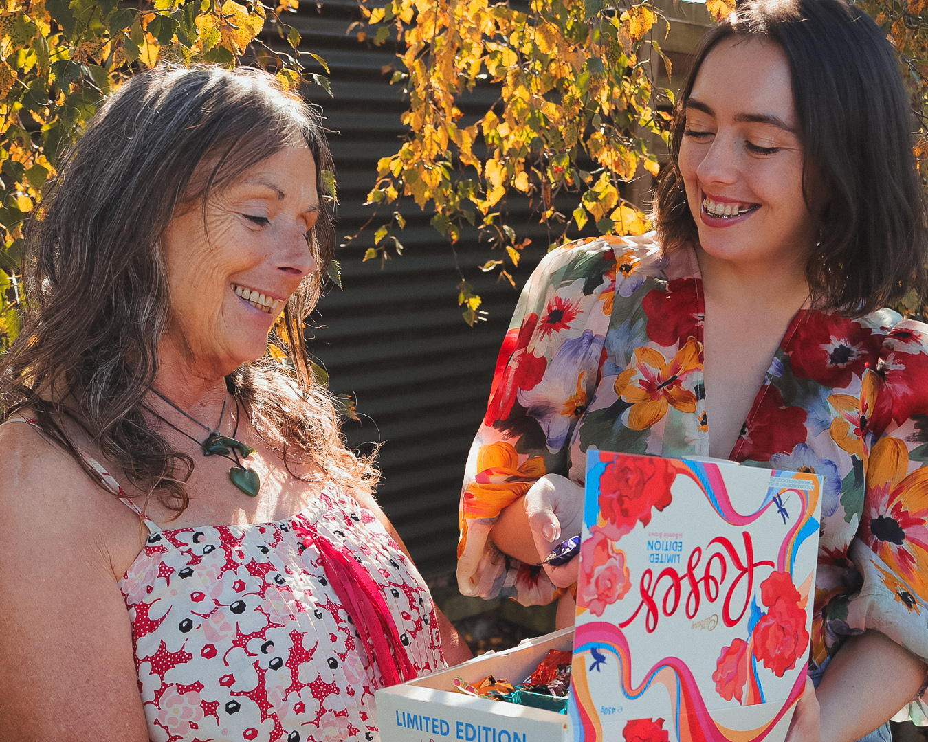 Bonnie Brown on the right showing her mother the new Cadbury Roses box.