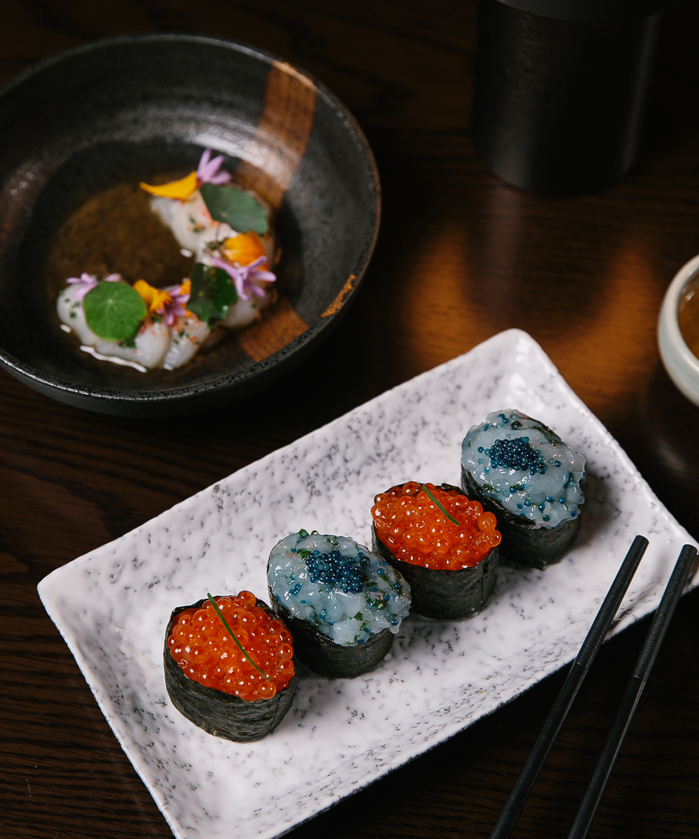 a plate of roe filled sushi