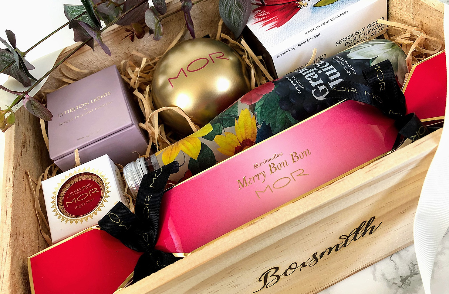 A Christmas gift box from Boxsmith showing a packed box of goodies for Christmastime.