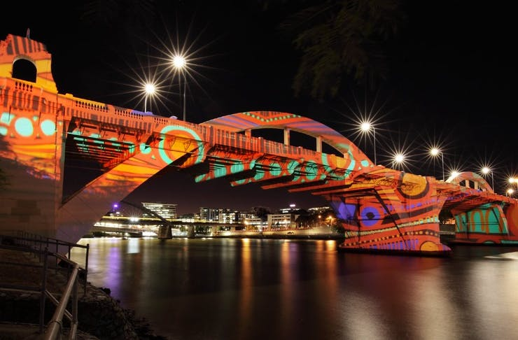 William Jolly Bridge lit up with artwork projected onto it