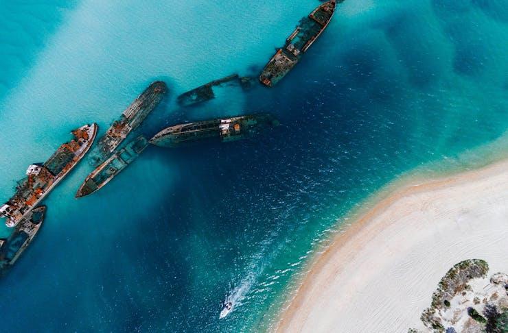 shipwrecks in a blue ocean