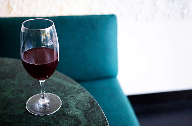 a glass of wine on a marble table