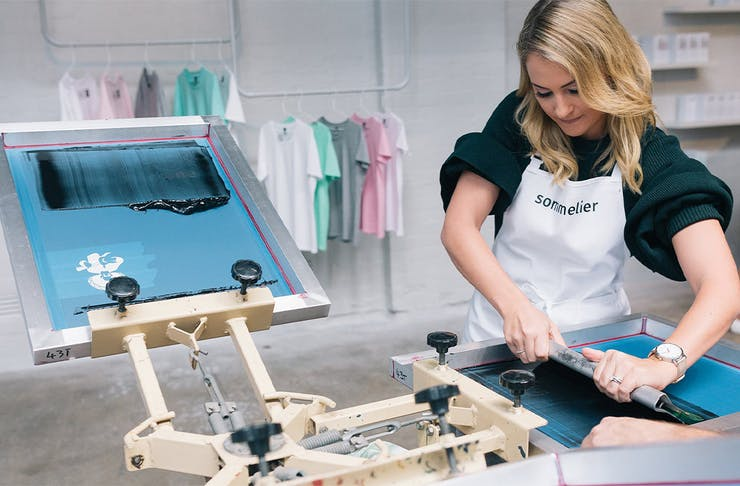a woman screenprinting a t shirt