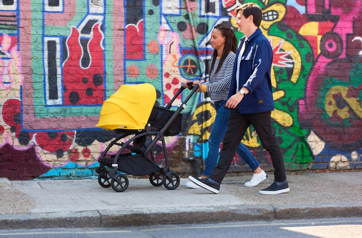 Young parents pushing a Bugaboo Bee 6 pram.