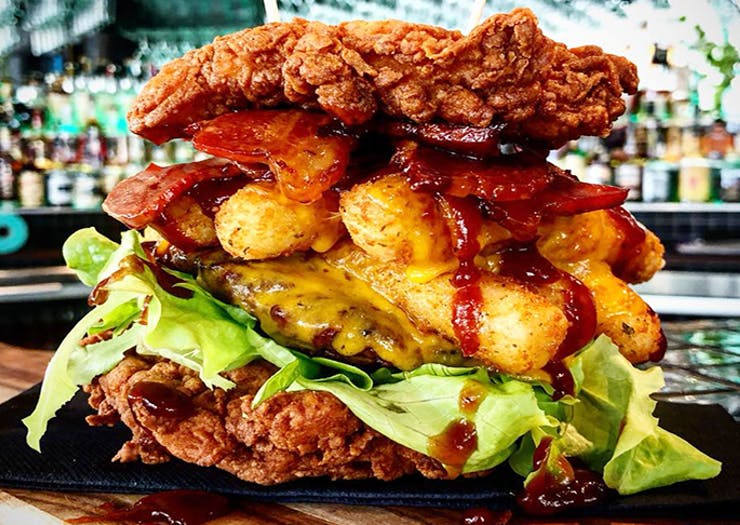 A Giant Buttermilk Chicken Burger Has Hit The Coast & It's Bacon Us All Crazy!