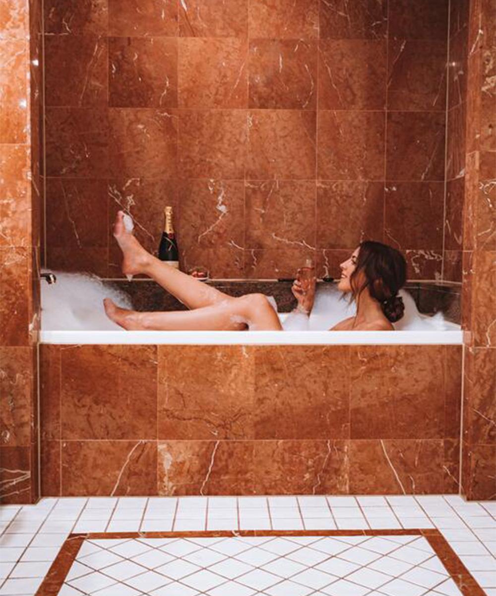 a woman in a bubble bath