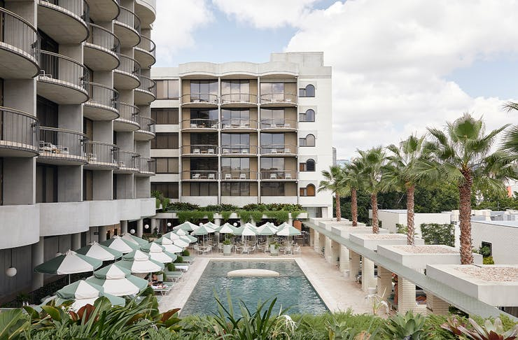 The brutalist exterior of the calile hotel and it's pool area