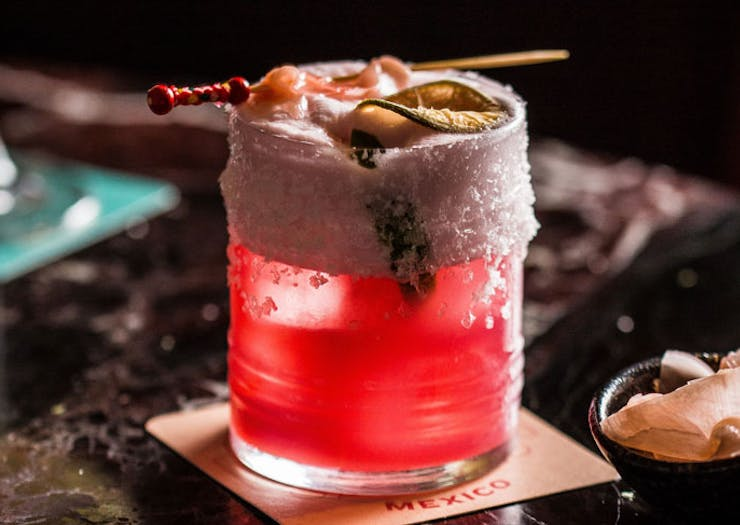 A bright pink cocktail.