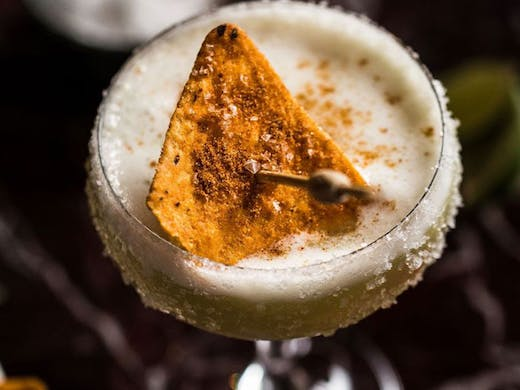 A margarita with a corn chip float.