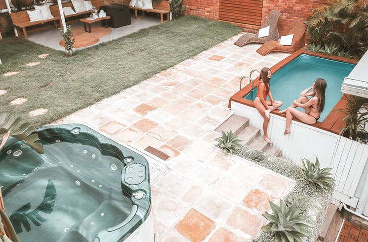 Outdoor spa, magnesium pool and seating area at Cenote Casa