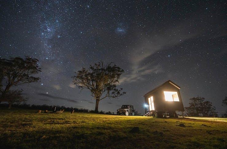 the tiny house under a starry night sky