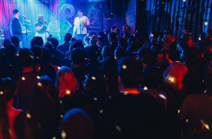 Revellers watch a band on the dance floor at Melbourne's Cherry Bar.