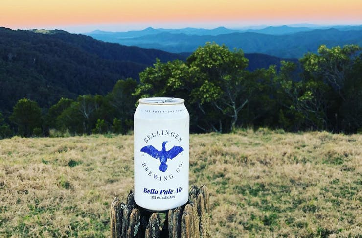 A Bellingen Beer Co beer can with green hills and a sunset in the background.