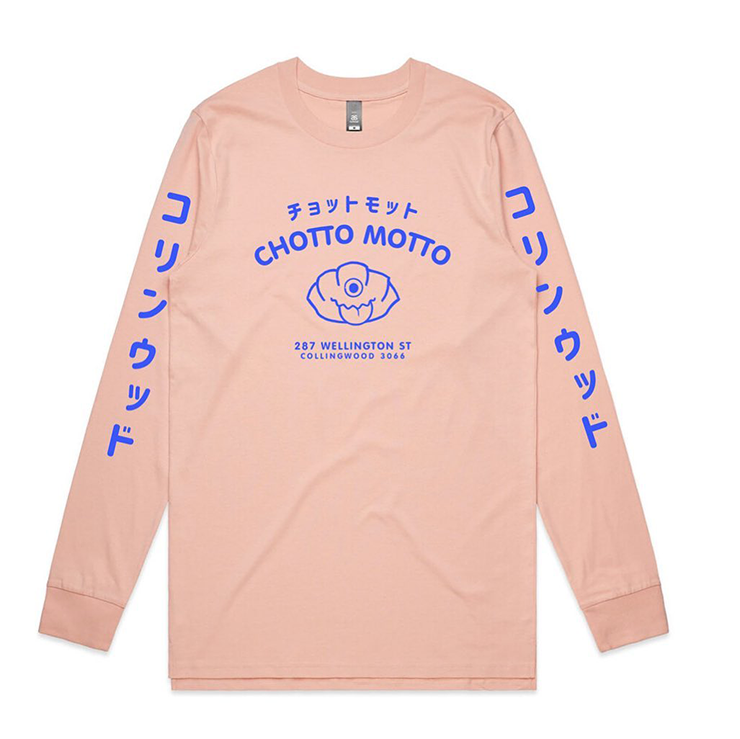 A pink long sleeve with blue text on the chest which reads
