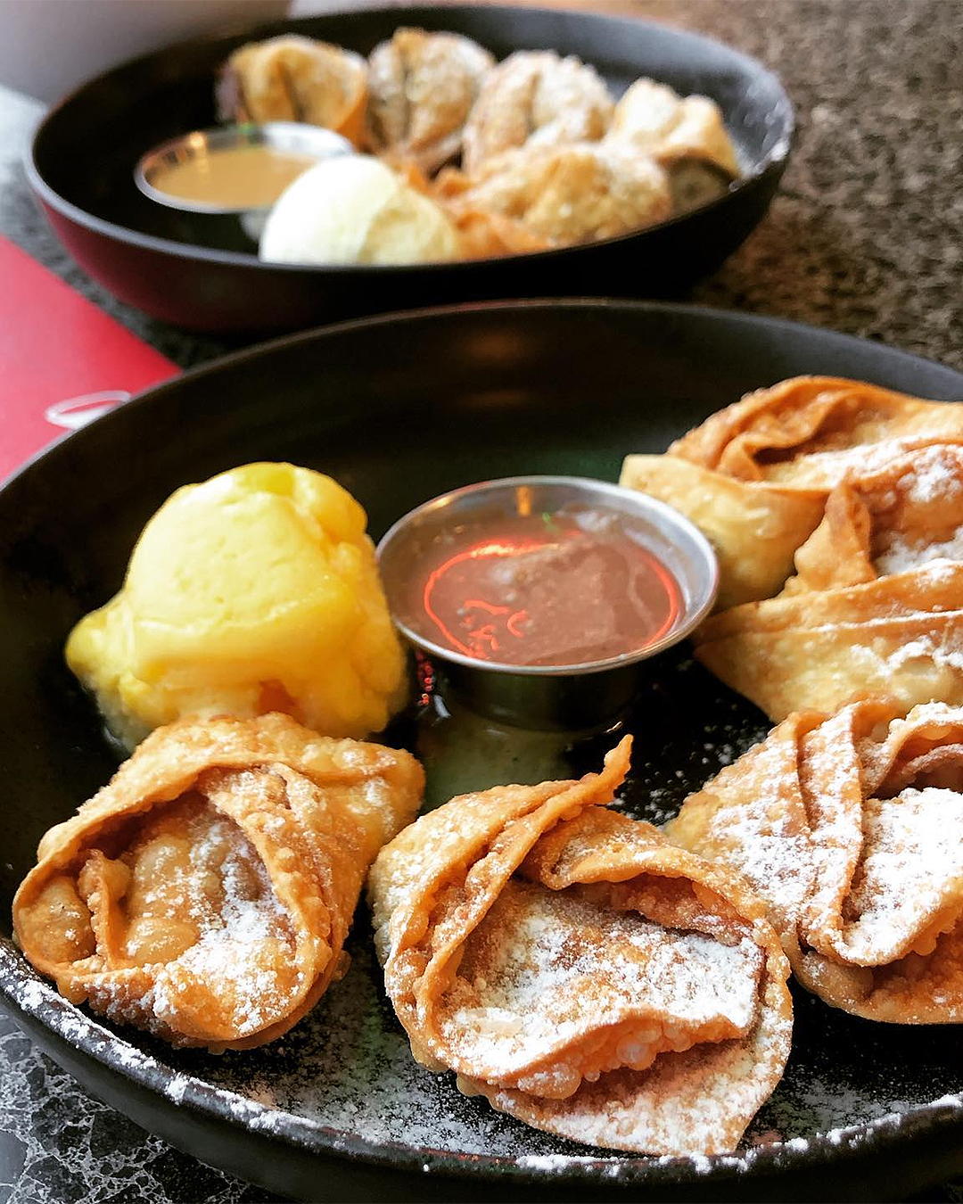 Date & Nut Parcels with orange sorbet and Banoffee Wontons with salted caramel sauce.