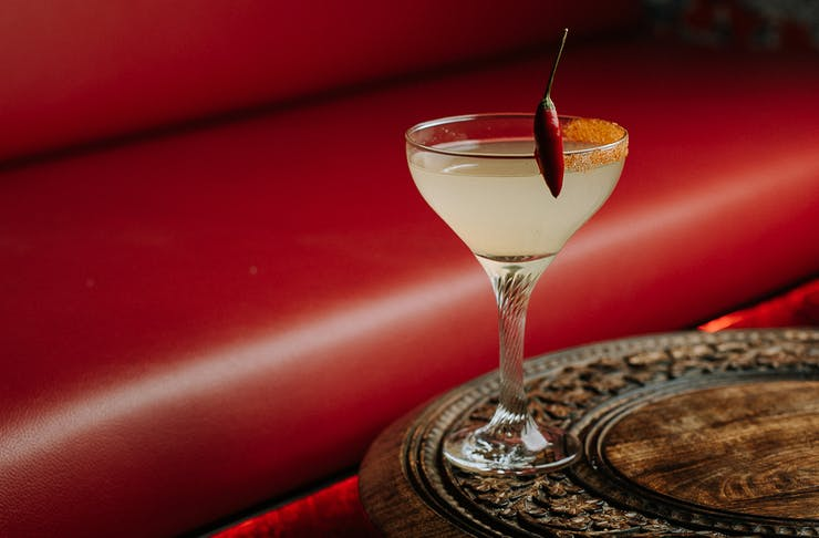 a cocktail with a chilli