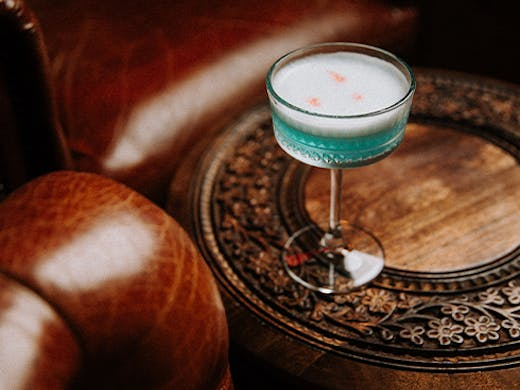 a cocktail on a wooden table