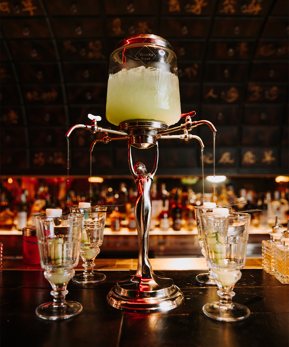 a cocktail tower filled with absinth