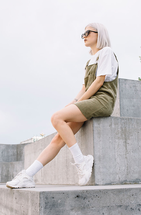 Girl sitting on a wall