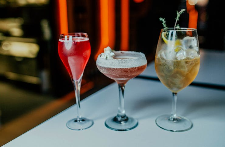 three cocktails in a row on a table