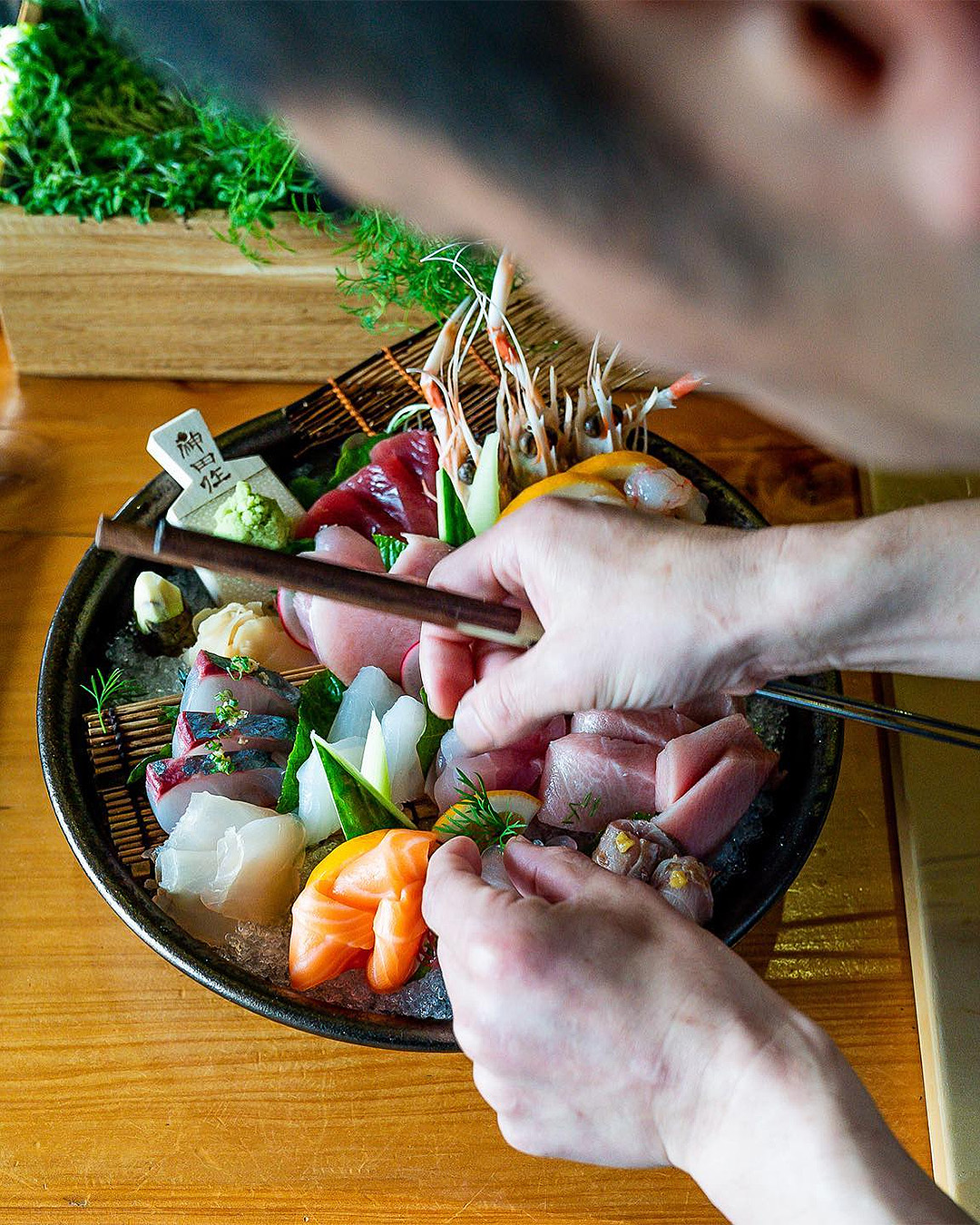 Makoto puts the finishing touches on a huge sashimi platter at Cocoro.