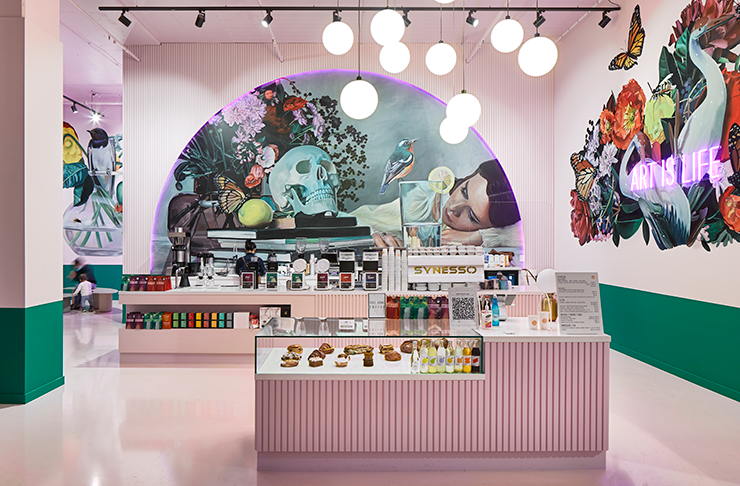 A pink cafe with large murals on the wall by artist Lisa King.