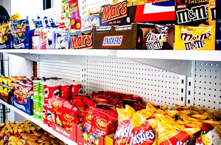 shelves filled with snacks at Convenients