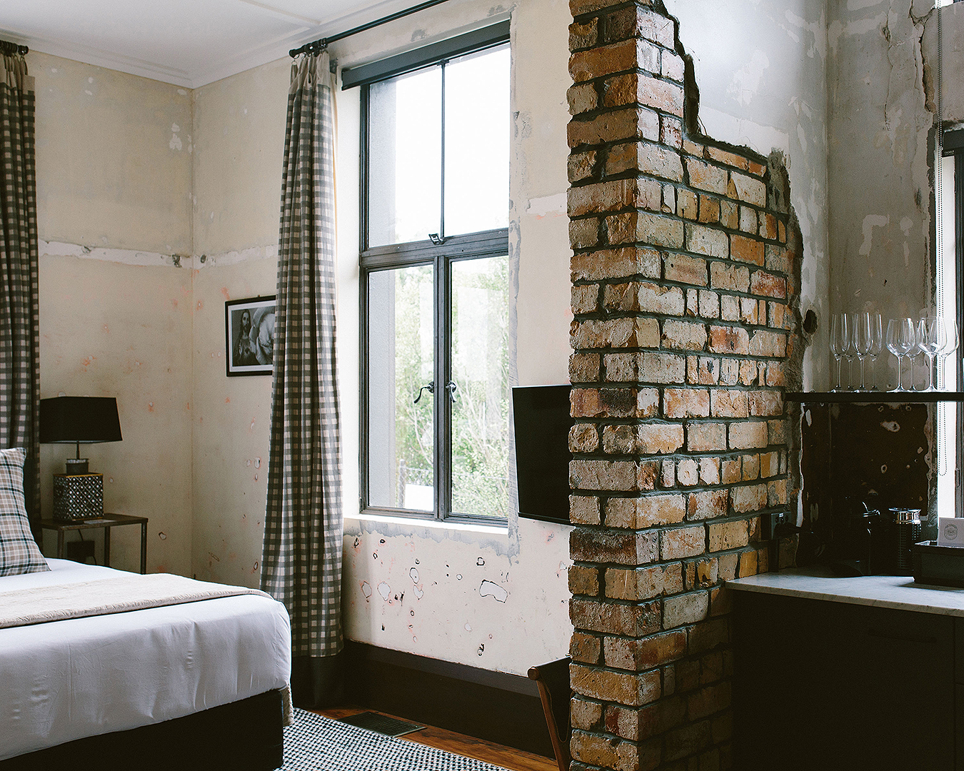 An exposed brick wall in a room at the Convent Hotel.