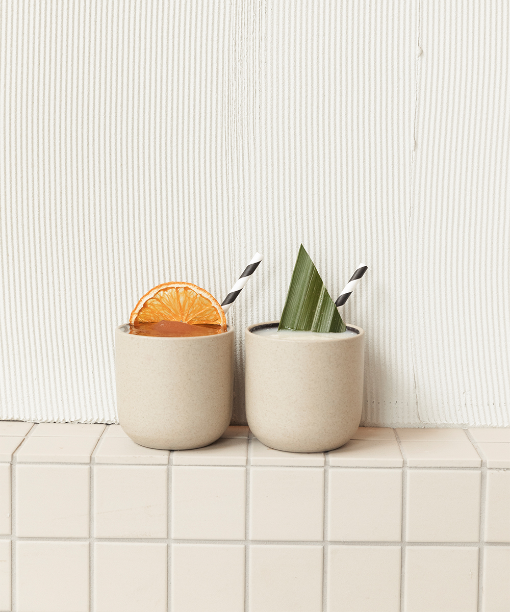 two ceramic cups side by side filled with frozen cocktails