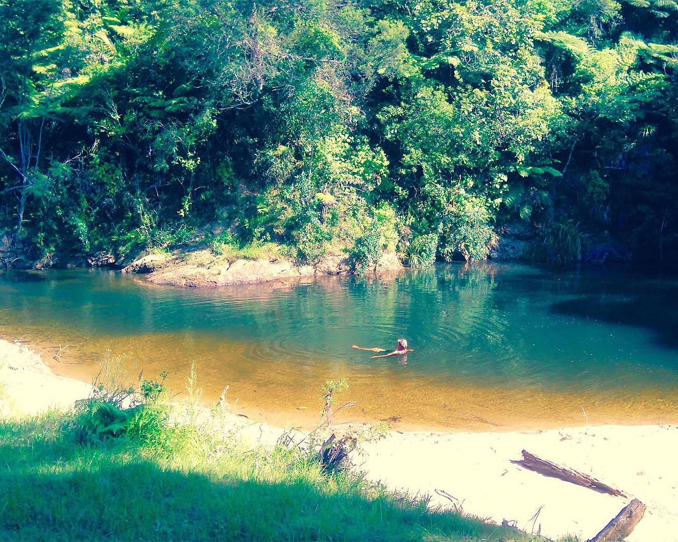 Someone swims at the swimming hole at Coro Camping Whitianga