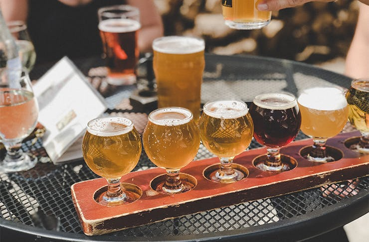 a tasting flight of beers on a table