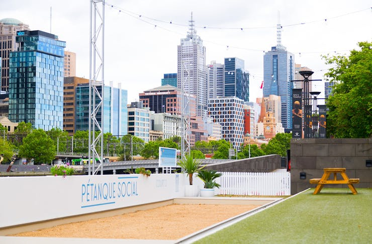 A large grassed area along Melbourne's riverbank.