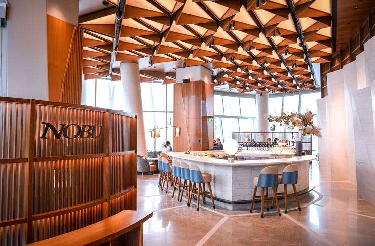 The entrance to Nobu in Sydney, which is flanked with timber.