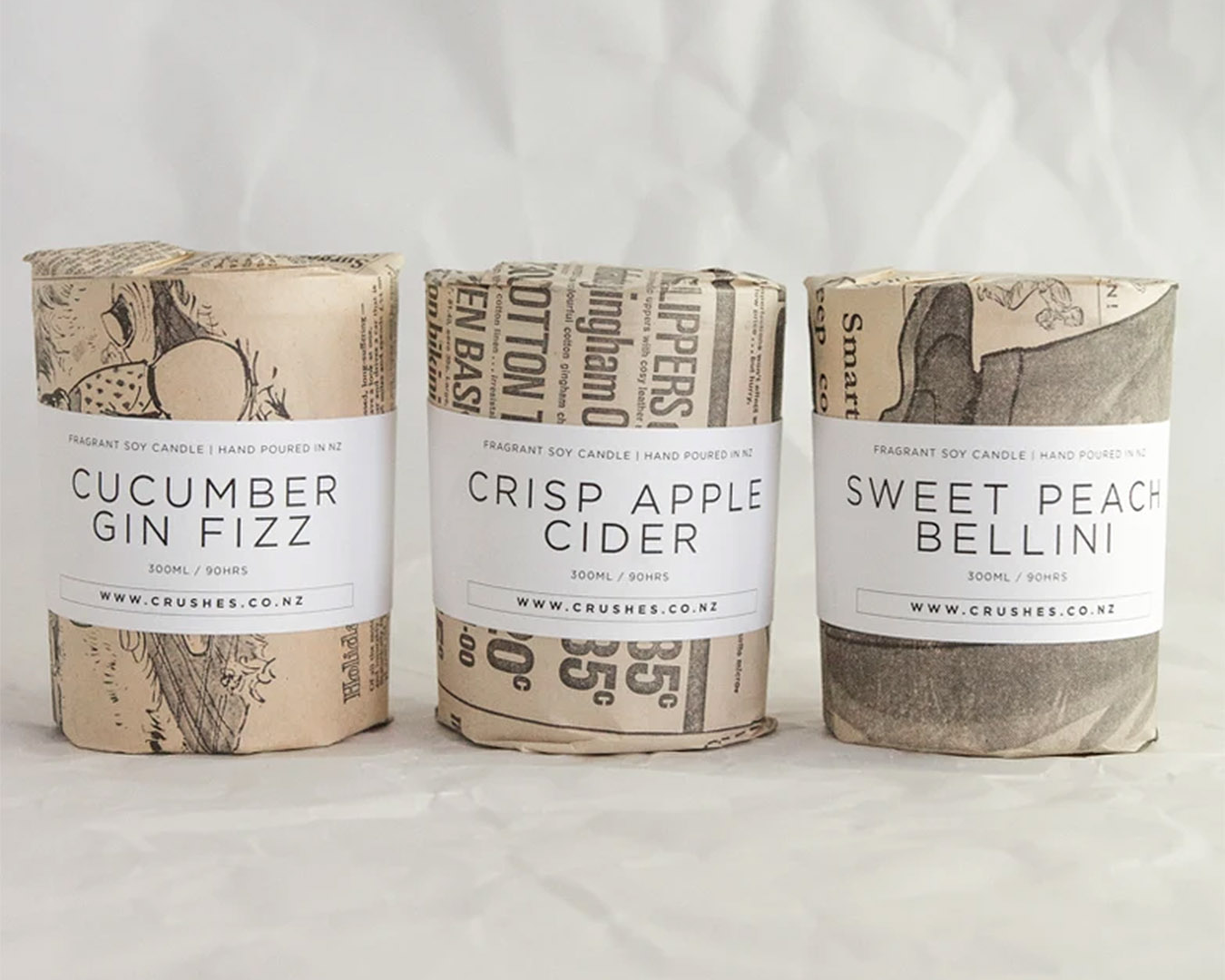 A cucumber gin fizz candle wrapped in vintage New Zealand newspaper