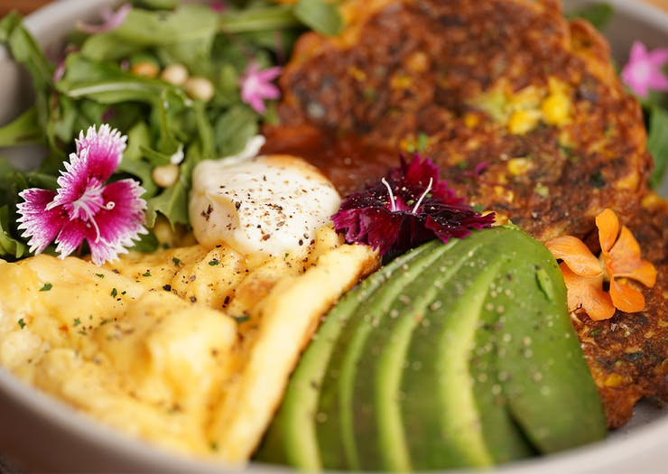 a bowl of corn fritters and avocado