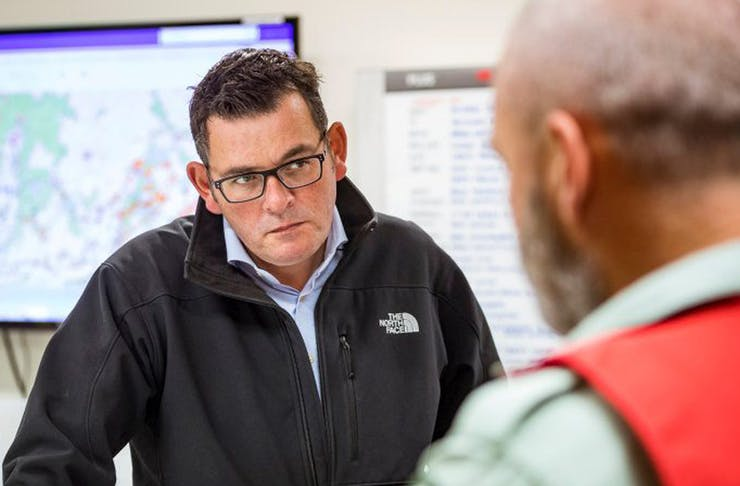 Victorian Premier Daniel Andrews meets with a worker wearing a The North Face Apex Bionic 2 Jacket.