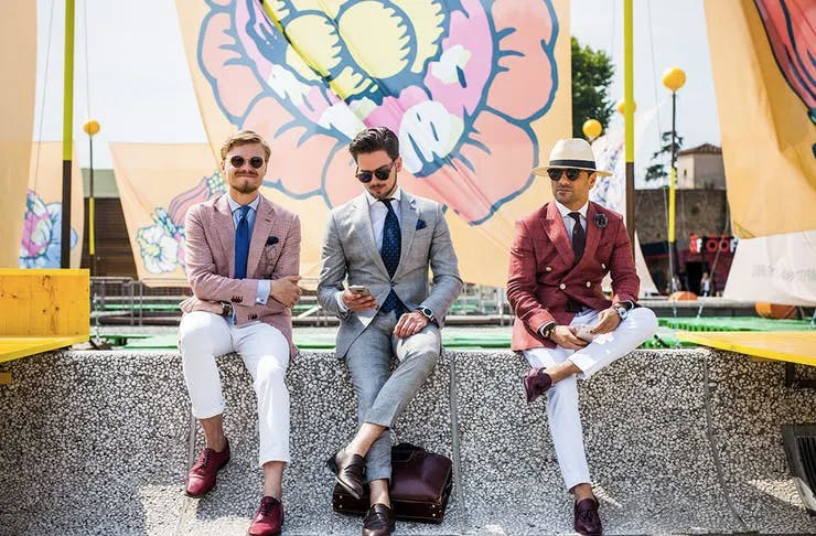 Three men sitting on a wall looking very dapper, The best places to watch the Melbourne Cup