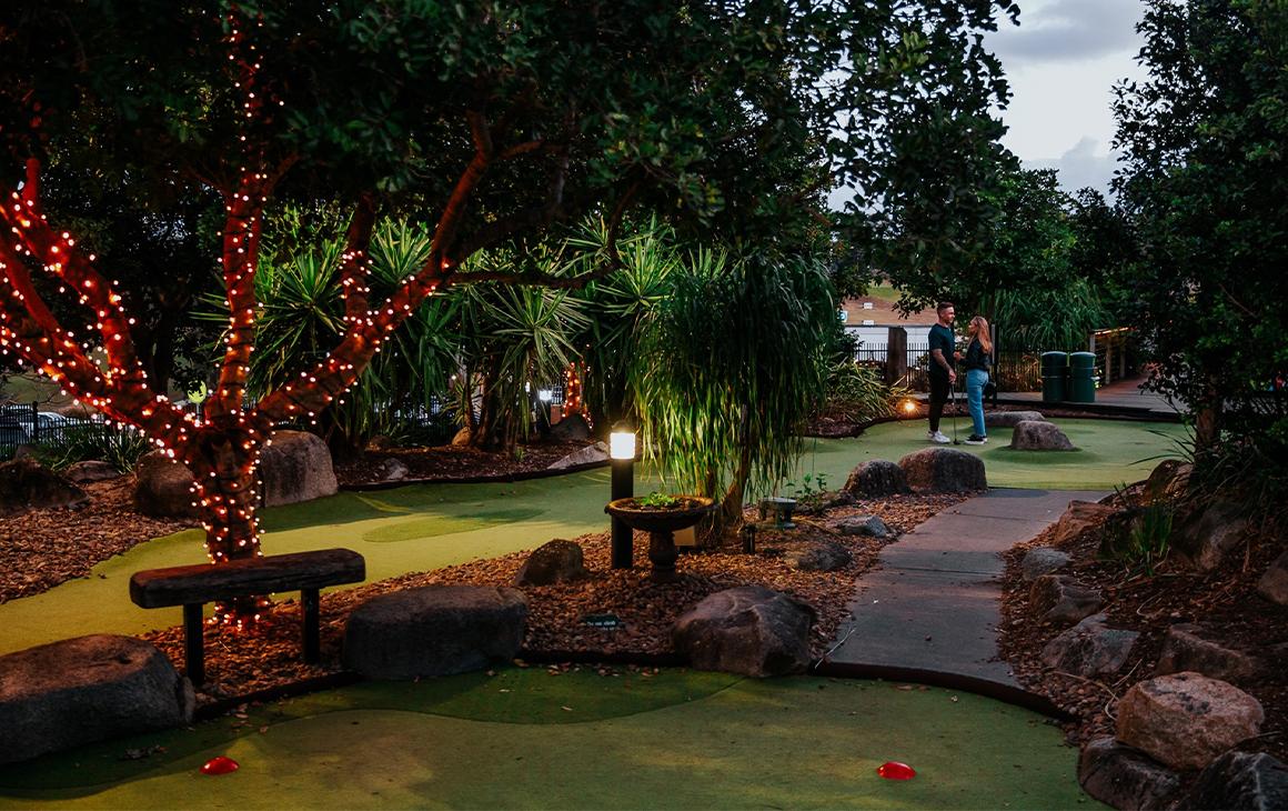 a mini golf course at twilight