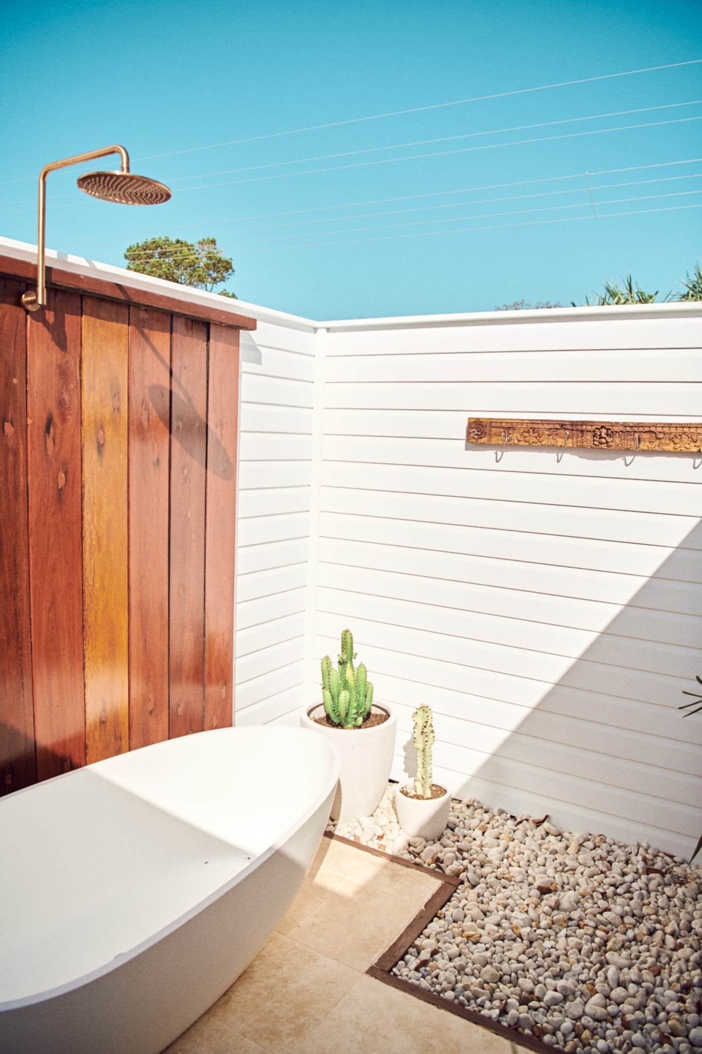 an outdoor shower and bath