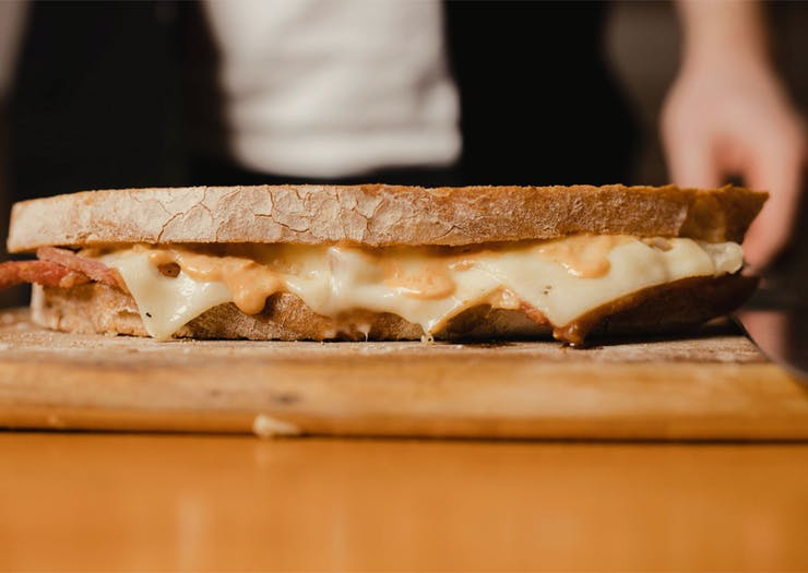 A deliciously long sandwich from Dedwood Deli shown from the side.