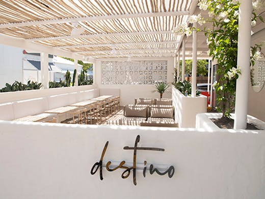 a stunning white timber deck surrounded by a white wall on which is written
