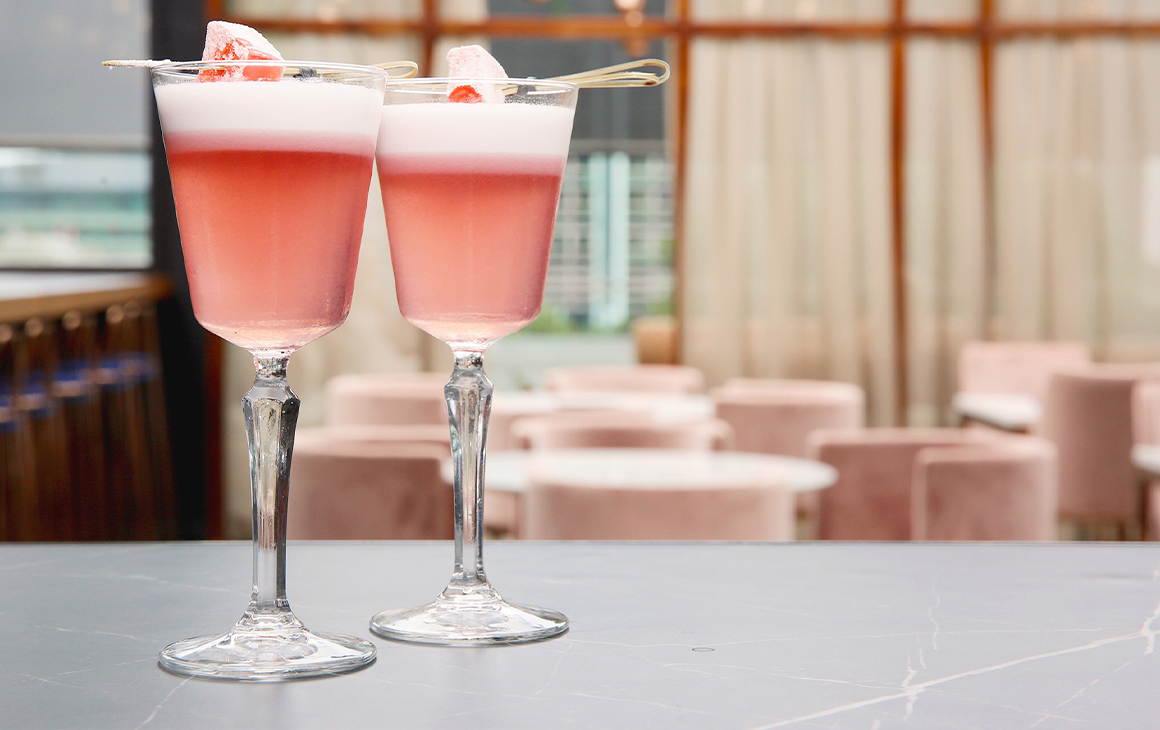 Two pink cocktails topped with Turkish Delight