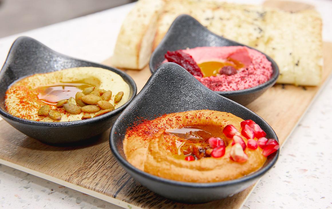 Three bowls of hummus