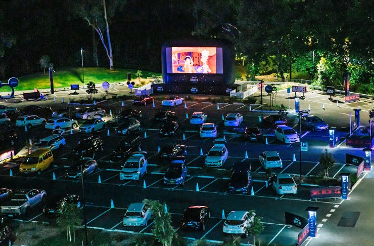 A drive in cinema at night.