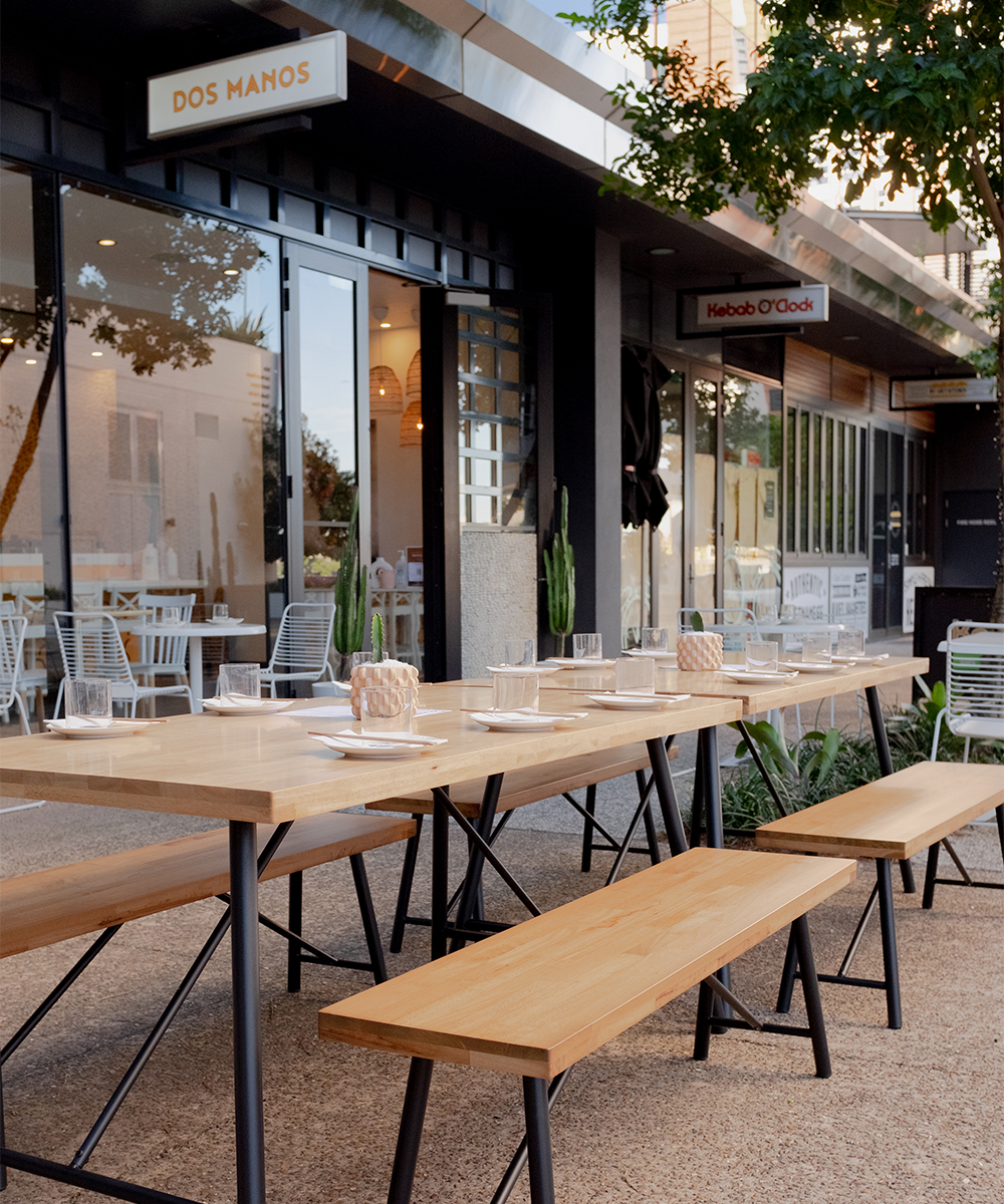 outdoor tables in front of the restaurant