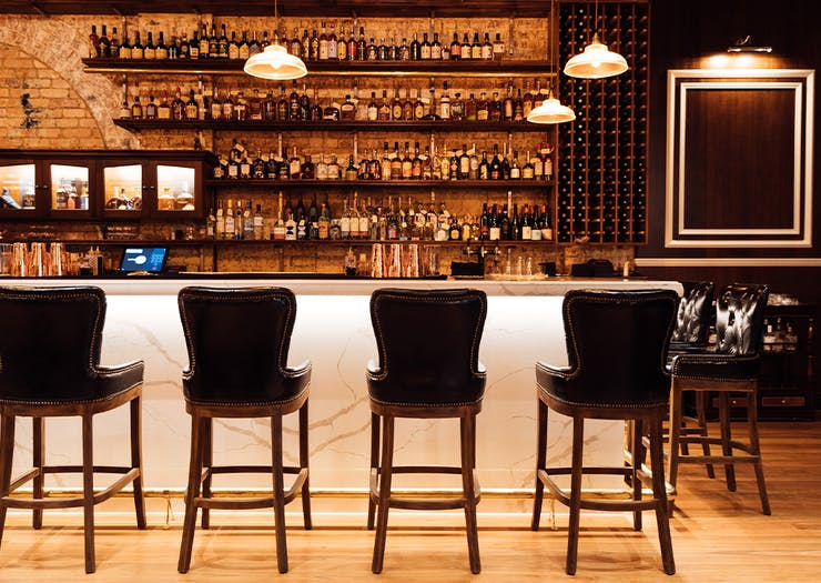a long bar with high stools along it