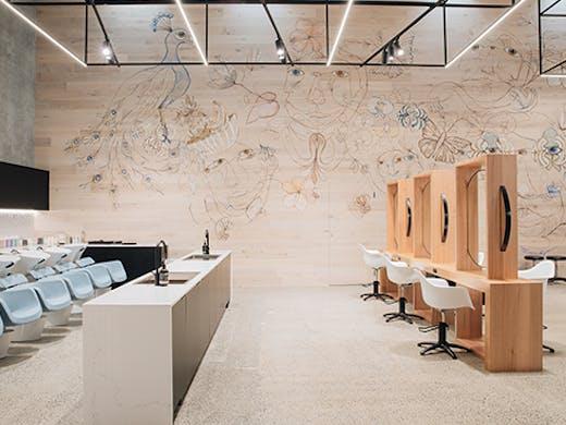 An image of a sleek hair salon, with a mural along one wall