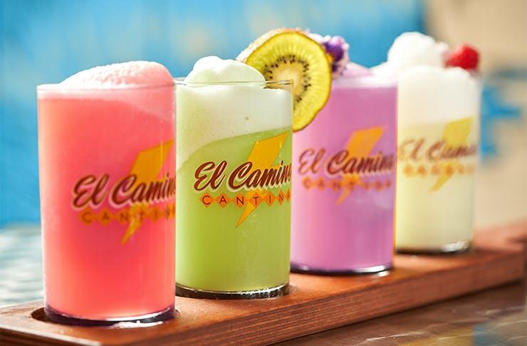 a row of four colourful margaritas
