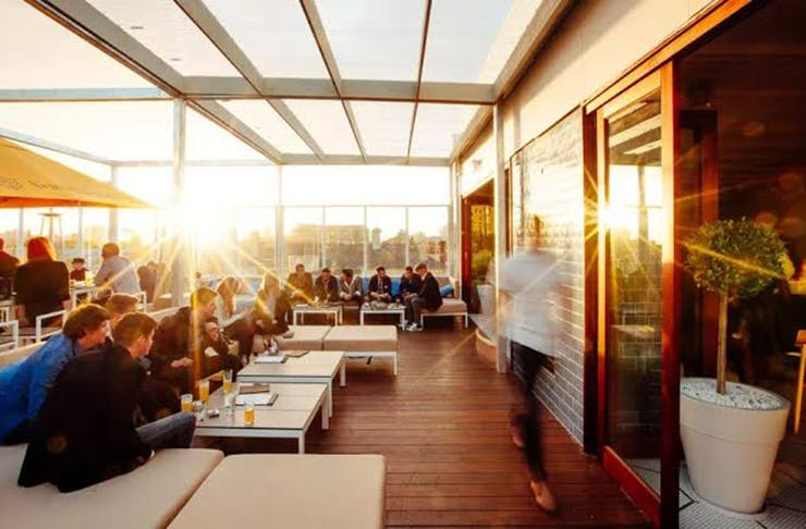 The sun shining over a rooftop bar in Melbourne.