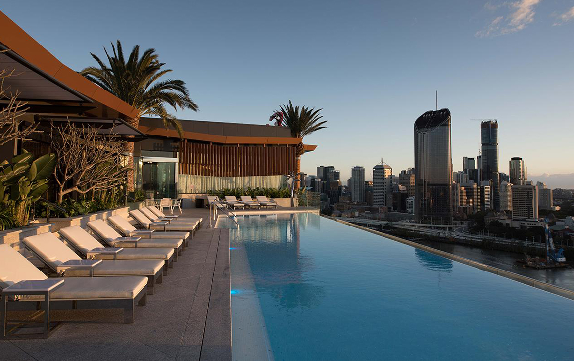 an infinity pool overlooking the Brisbane city skyline